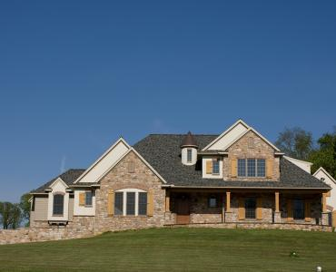 custom home with stone and wood exterior
