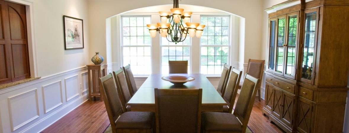 fining room with large windows and chandelier