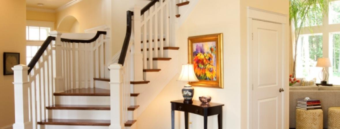 custom wood flooring in foyer and view of second floor staircase