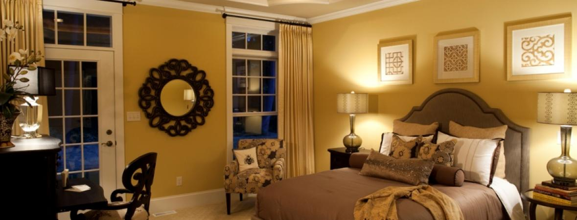 comfortable bedroom with recessed lighting