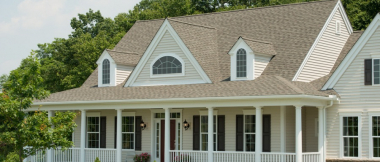2-story house with wrap-around porch