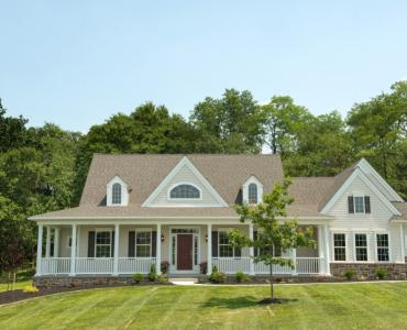 cream custom home with large front porch