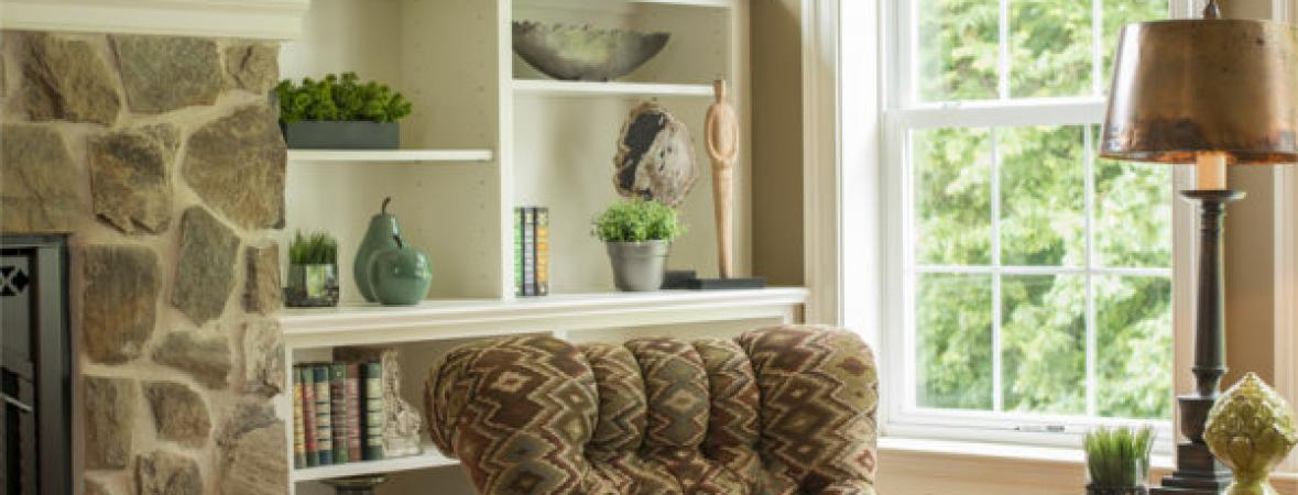 detail of armchair and matching foot rest and built-in storage shelves