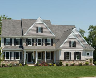 house with vinyl siding and stone veneer
