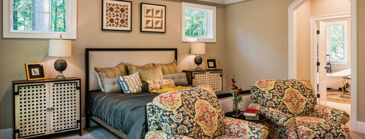 master bedroom with armchairs