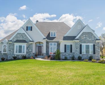 beige custom home with stone veneer
