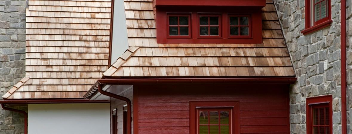 roof shingles on gray house with red accents