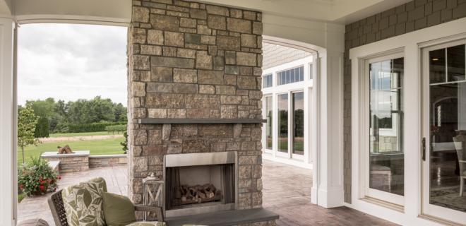 outdoor patio with stone fireplace