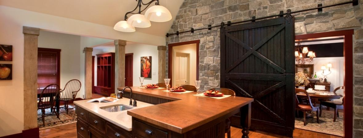 kitchen with sink in island with dining bar, sliding barn door to dining room