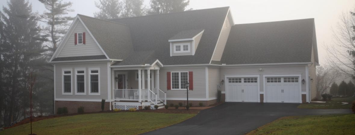 Cream Colored Two Story House With Attached Garage
