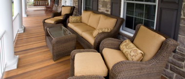front porch with furniture set, rocking chairs, and porch swing