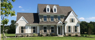 custom home with vinyl siding and stone veneer