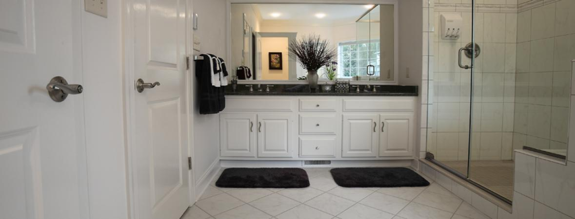 double sink vanity in master bathroom with large walk in shower unit