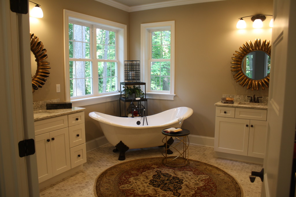 claw-foot bathtub between two vanities