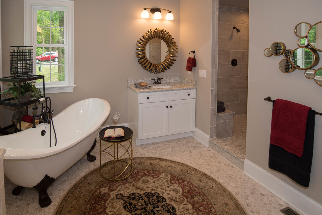 bathroom with claw-foot bathtub and walk-in shower