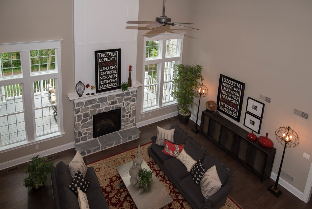 aerial view of living room with fireplace