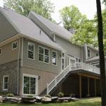 custom home with backyard deck