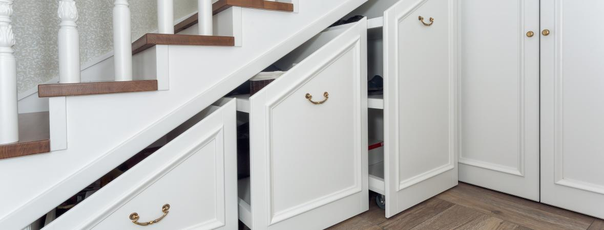 staircase storage - pull-out cabinets