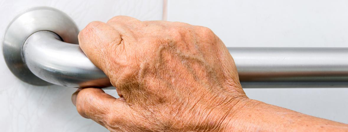 make home more accessible - elderly hand grabbing support bar