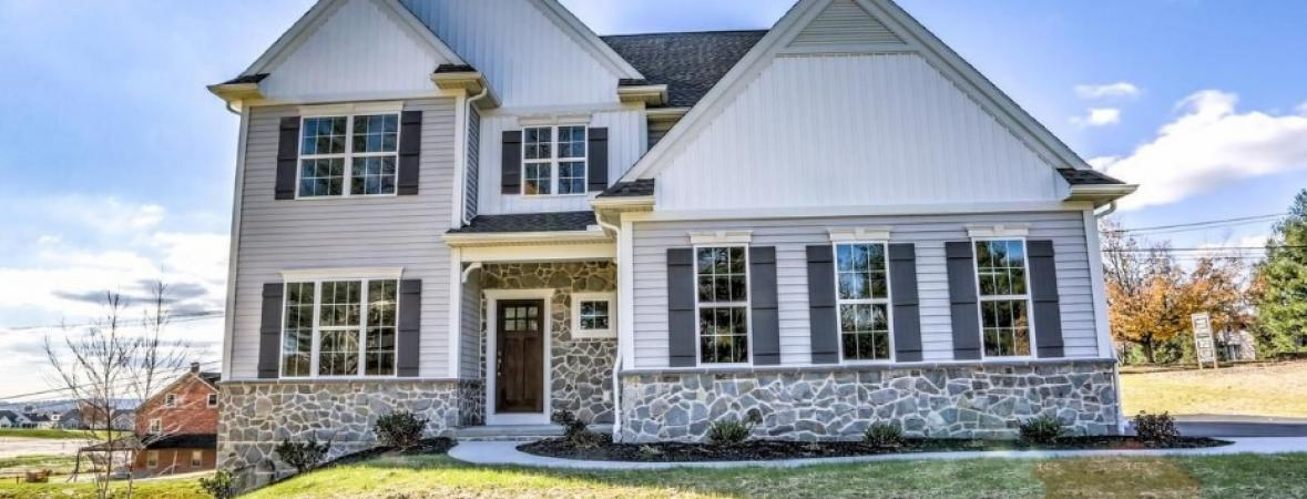 white home with tan and stone veneer accents
