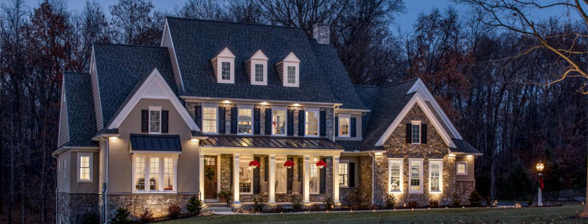 signs it's time to start looking for another home - custom home lit up at night
