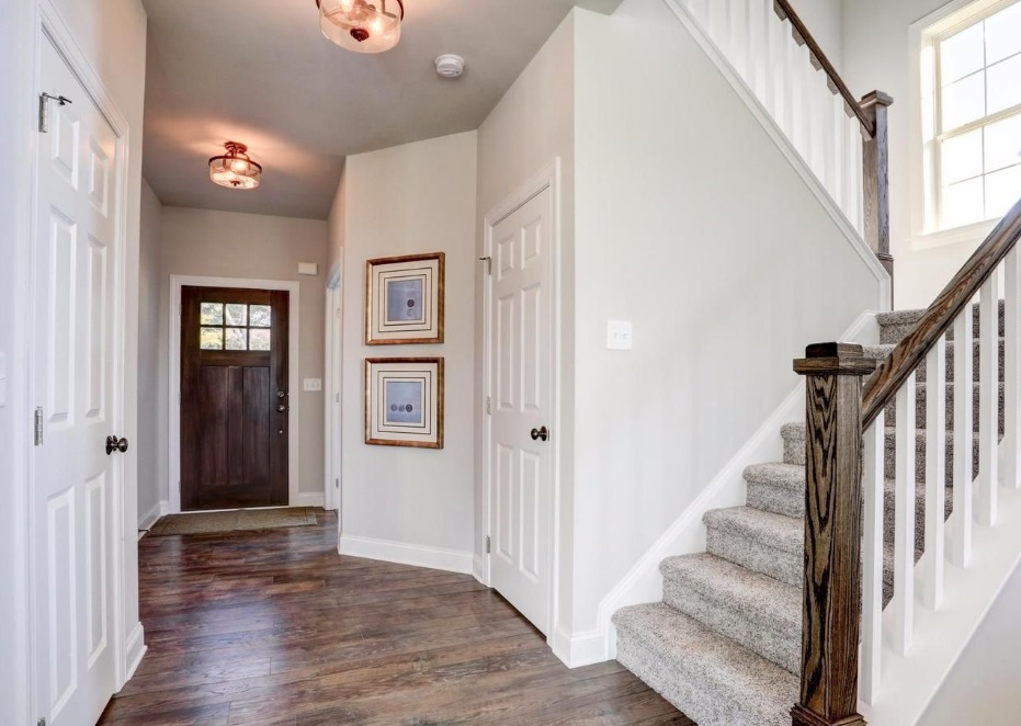 view of foyer and stairs to second floor