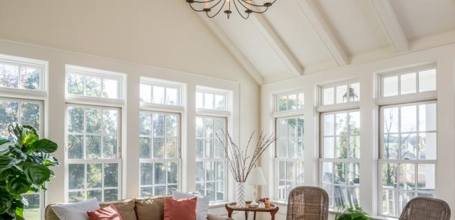 sunroom with chandelier