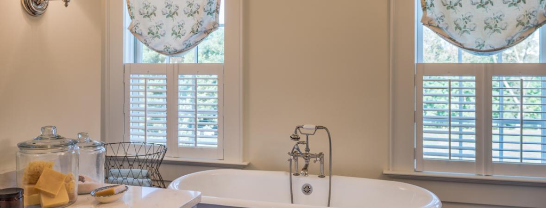 custom home bathroom with standalone tub