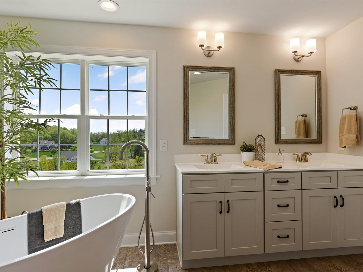 freestanding tub and double vanity in master bath