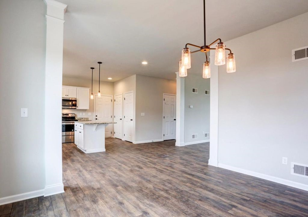 dining room with chandelier and kitchen with island