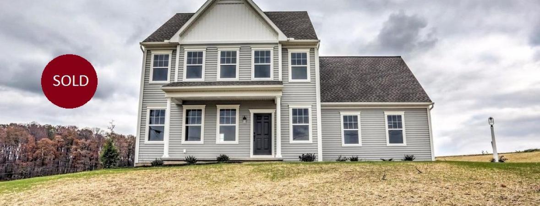 exterior of custom home with gray vinyl siding