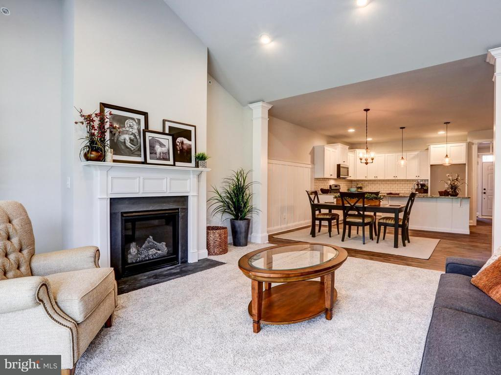 great room - living room with fireplace, dining room and kitchen
