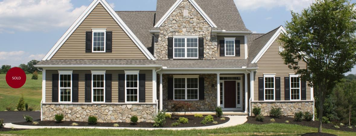 custom home with stone veneer