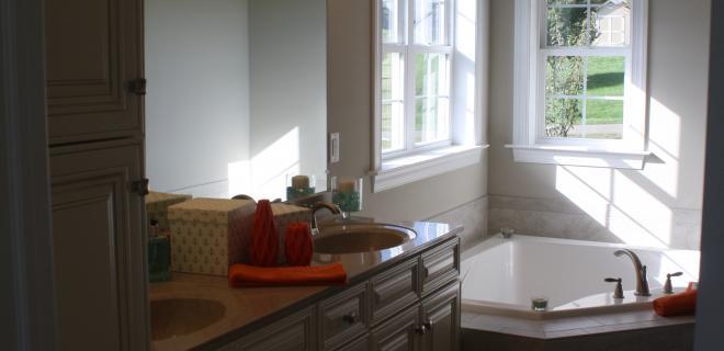 double vanity sinks and corner bathtub