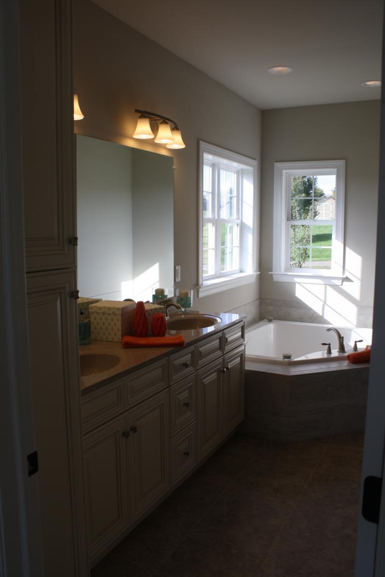 double vanity sinks and corner bathtub