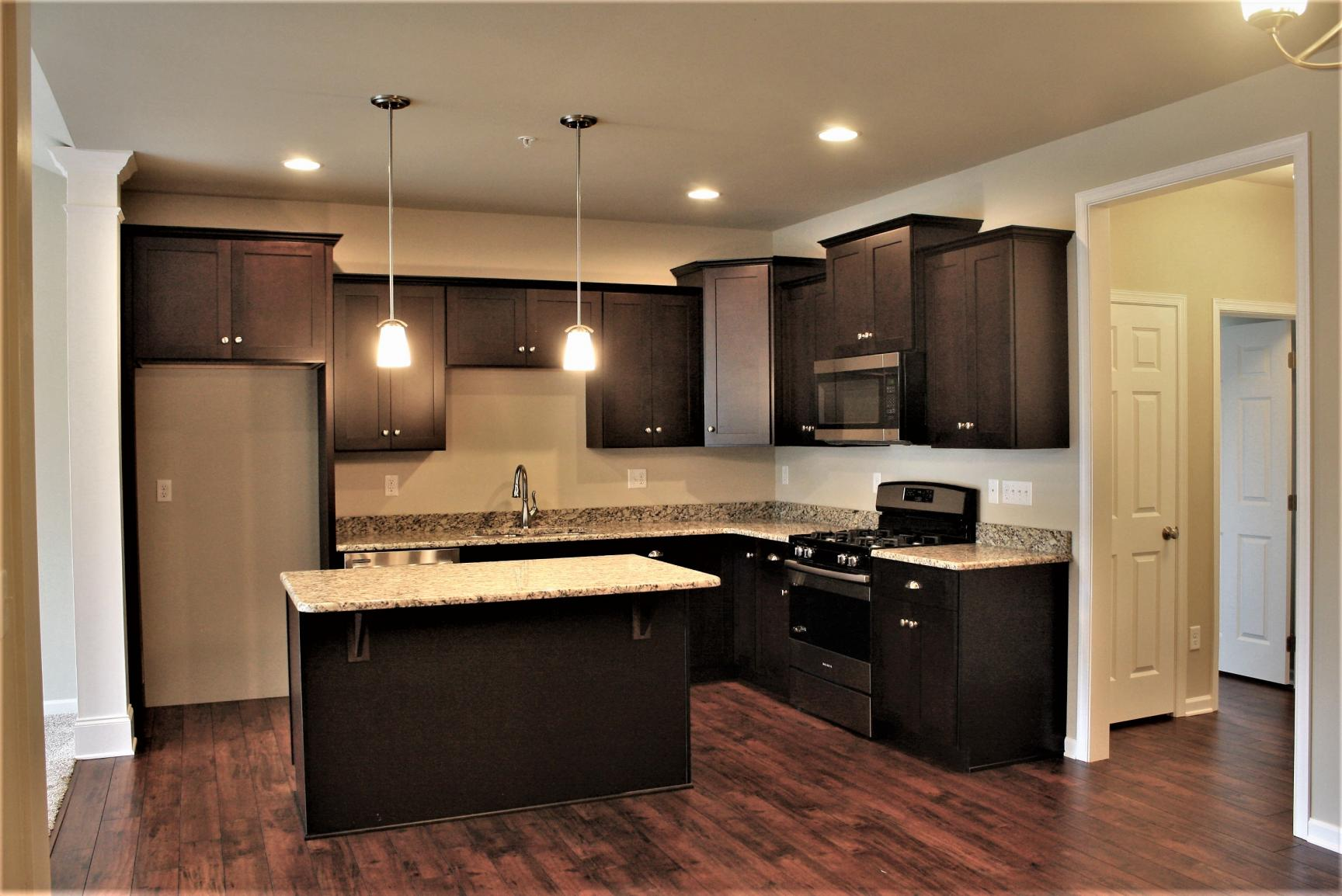 kitchen with brown cabinets and island