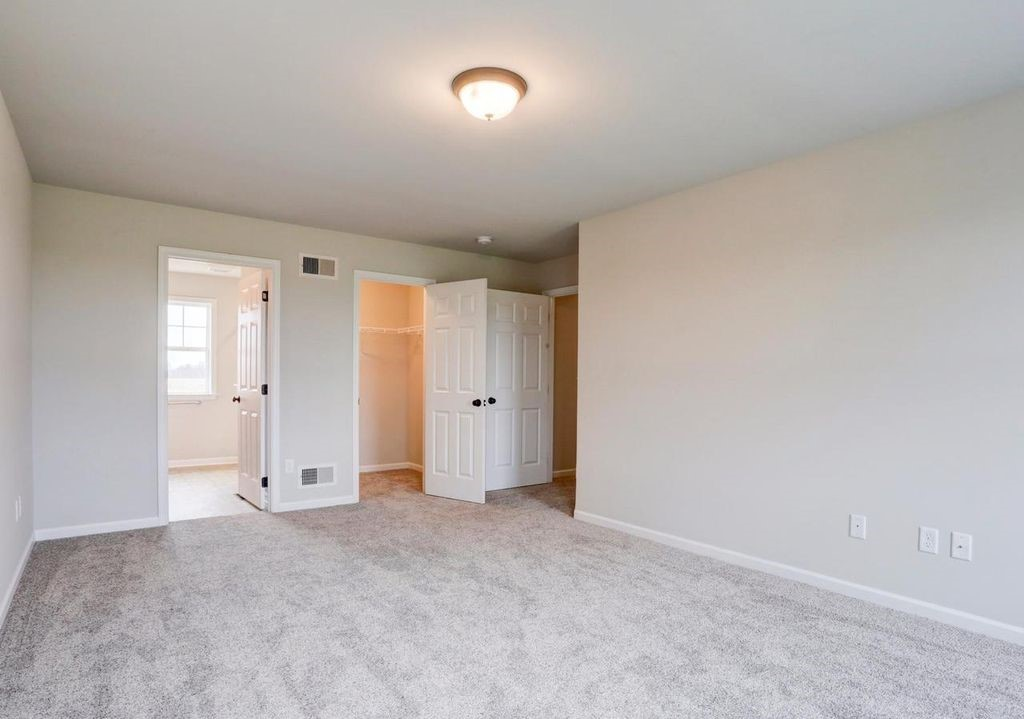 master bedroom with walk-in closet and master bathroom