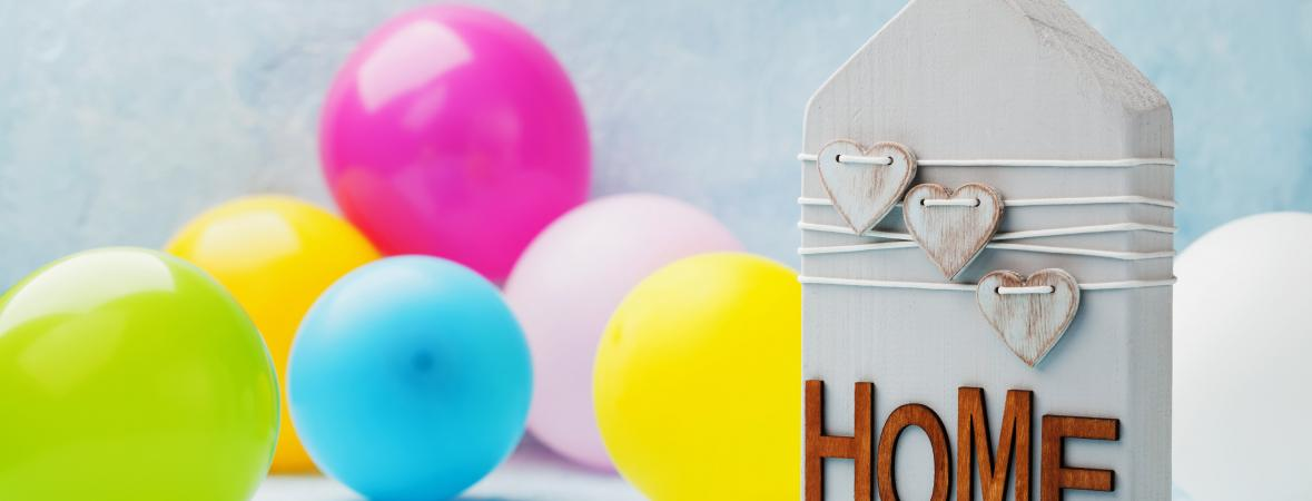 housewarming party - house-shaped block with home on it and balloons