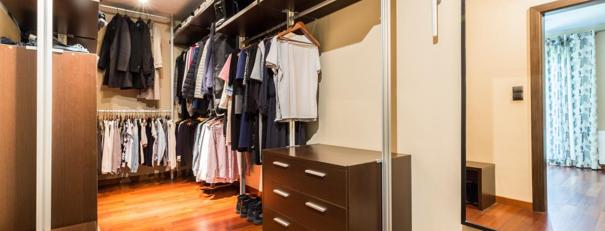 walk in closets - large walk in closet with wooden cabinets