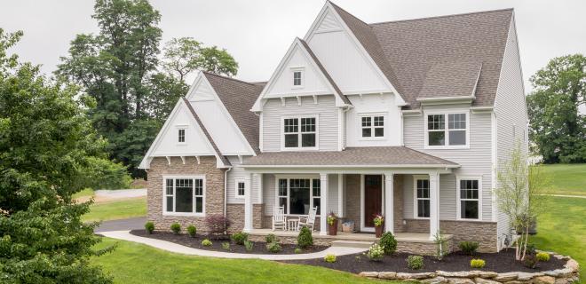 spring home maintenance tips - exterior of custom home
