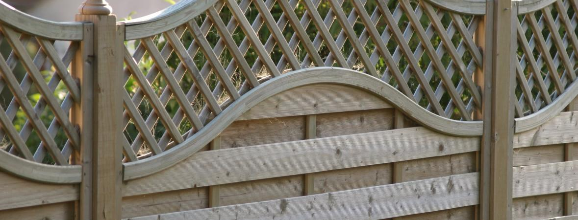 wooden fence with decorative trellis