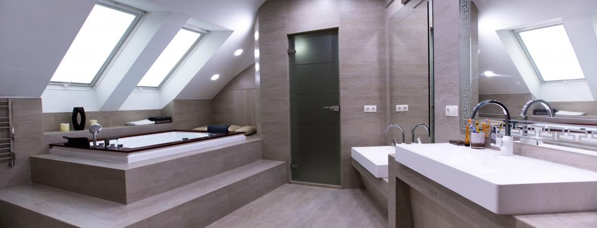 large modern bathroom with sunken bathtub