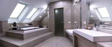 large modern bathroom with sunken bathtub