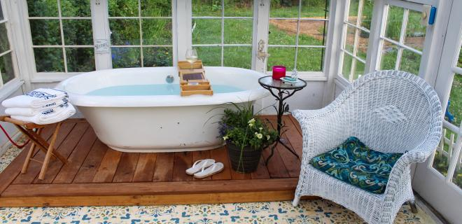 outdoor soaking tub in a greenhouse