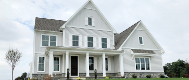 exterior of custom home with gray siding