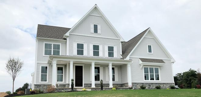 exterior of custom home with gray siding