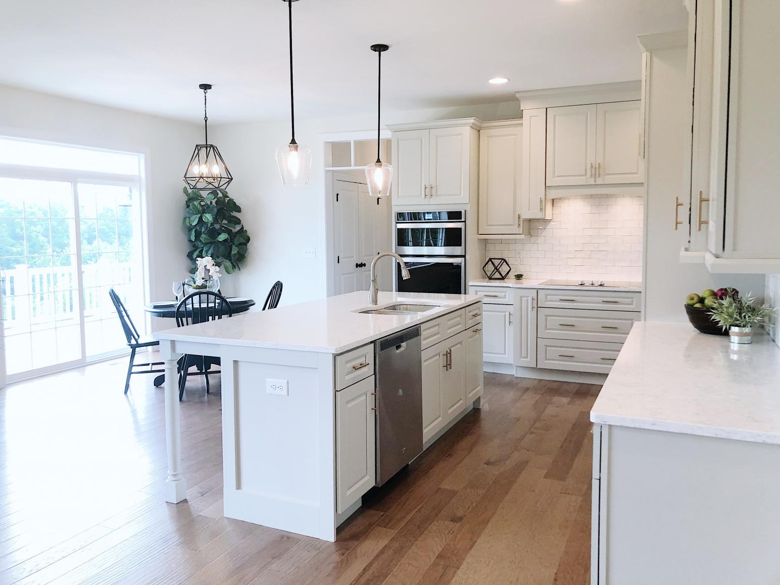 kitchen with island and dining room