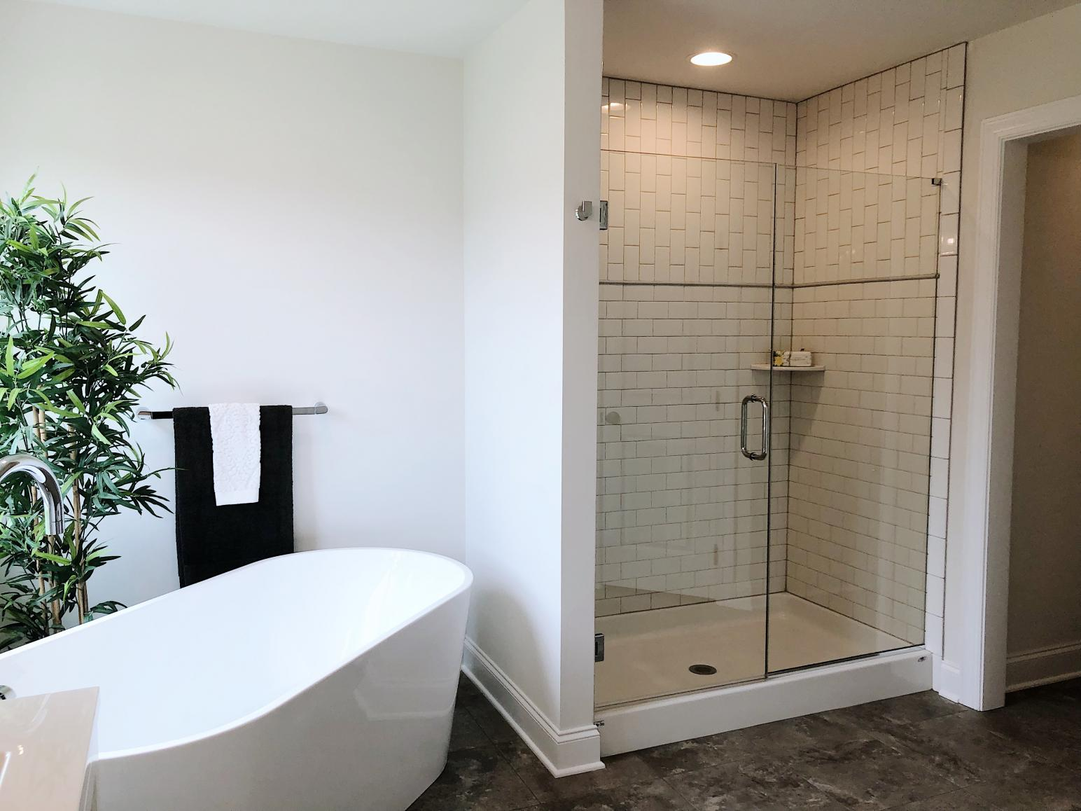 tub and walk in shower in master bath
