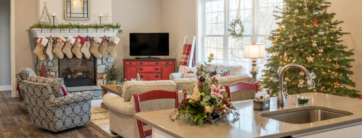 great room with fireplace decorated for christmas