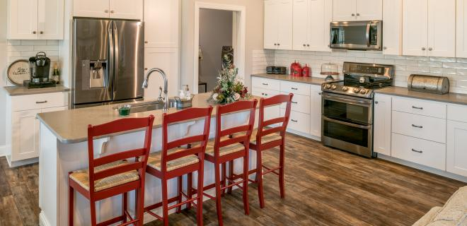 kitchen with island that has red chairs
